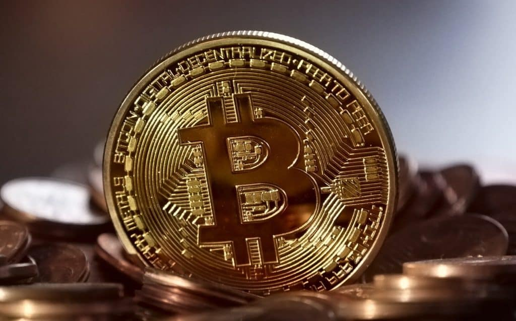 image of a Bitcoin coin among other coins